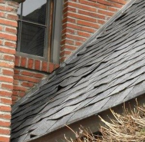 Loose, bubbled roof shingles